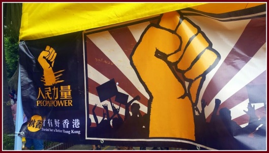 """Power to the People: Persist for a Better Hong Kong""    Photo by Mai Perkins during the July 1st March in Hong Kong."